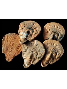 Mascheroni in terracotta toscani