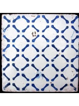 Antica piastrella di maiolica blu e bianca