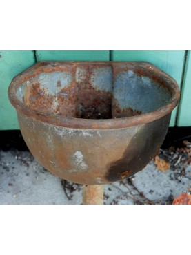 ancient Tiny watering hole in cast iron