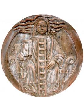 Allegory of Alchemy from Notre Dame de Paris in terracotta