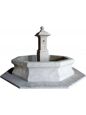 Grande fontana circolare in pietra calcarea
