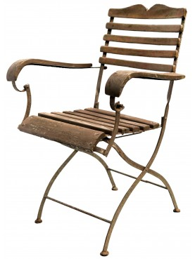 Ancient armchairs in wood and wrought iron