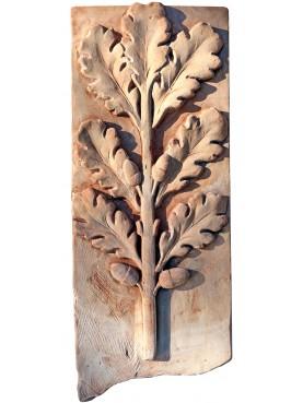 Bassorilievo in cotto - tralcio di quercia con ghiande