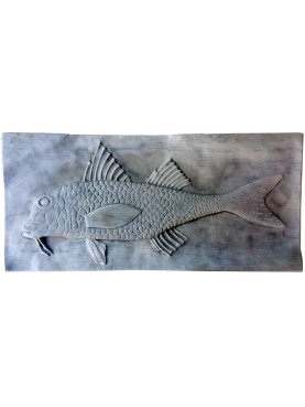 The striped red mullet on white Carrara marble slab