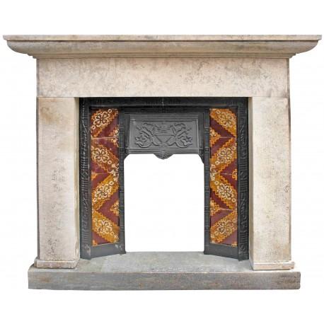 Limestone fireplace with cast iron heart