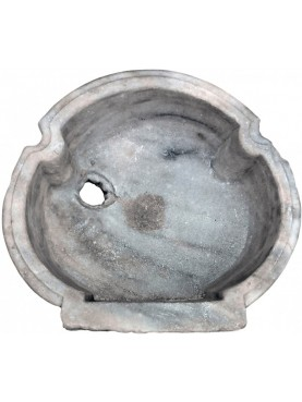 Trilobate ancient sink in white marble
