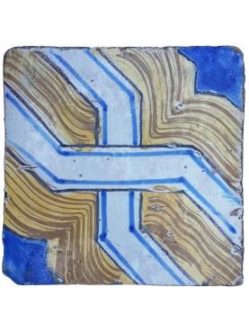 Piastrella antica di maiolica nodo continuo