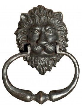 A lion's head door knocker with handle castiron