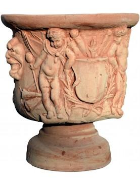 Vaso con putti, maschere e stemma terracotta Impruneta