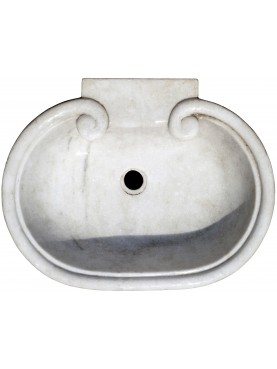 White marble sink with two volutes