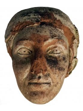 Roman female face fragment
