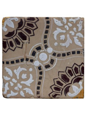Majolica tile with brown and white design