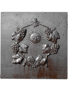 Cast iron fireback with sun Sun and clusters of grape