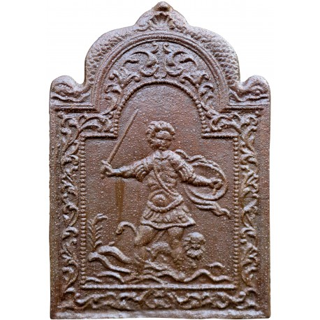 Cast iron fireback with armed warrior