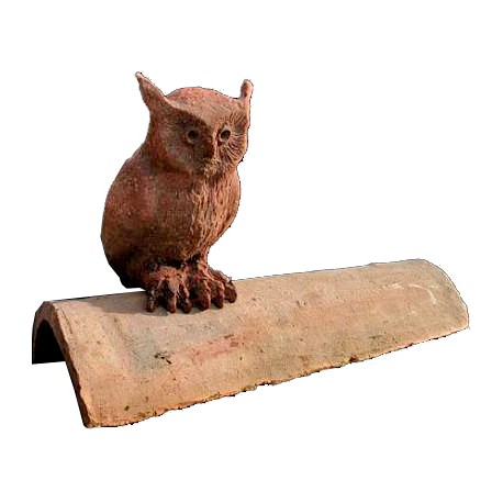 The owl on an ancient roof tile