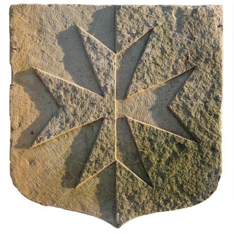 Maltese cross carved in stone