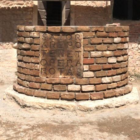 Pozzo del sator in pietra e mattoni