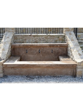 Large fountain in limestone with three bronze faucet