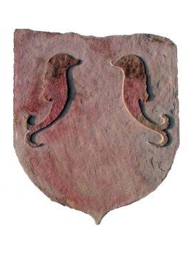 Sand stone coat of arms with dolphins