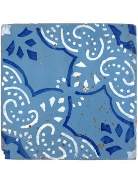 Antica piastrella di maiolica blu