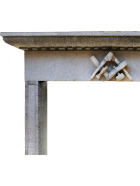 Sandstone fireplace with the symbol of the Compagnons