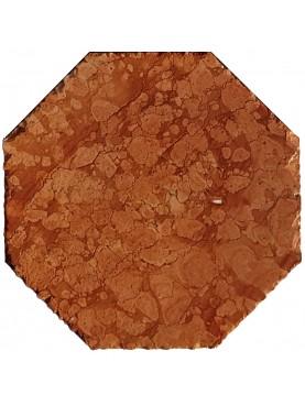 Pavimento a esagoni e triangoli in pietra bianca calcarea e terracotta rossa