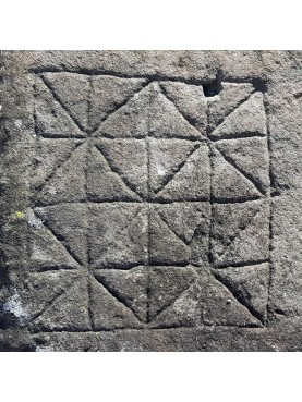 Large ancient stone with engraving of the Nine men's morris