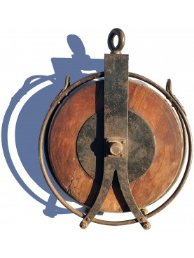 Huge wooden and iron pulley