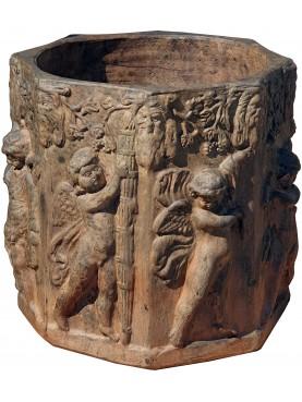 Octagonal cachepot decorated with terracotta cherubs