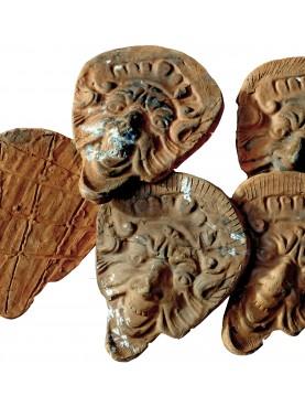 Mascheroni in terracotta toscani antichi