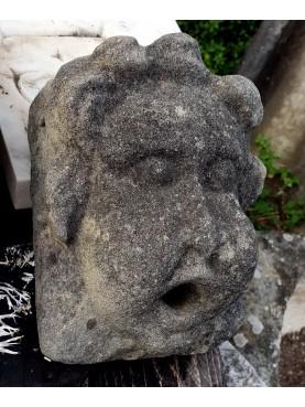 Fountain masks in limestone