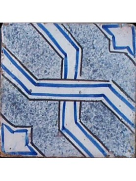 Piastrella antica di maiolica