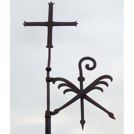 ancient Wind vane with cross and flag