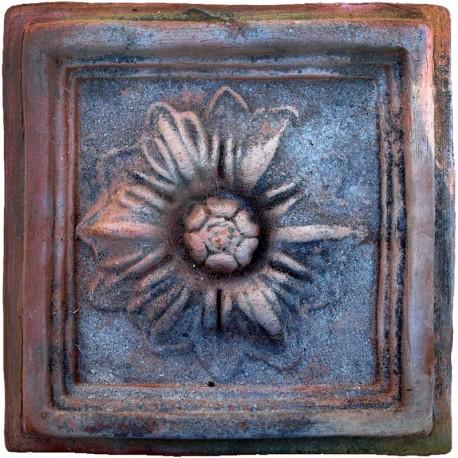 Formella in terracotta con rosetta