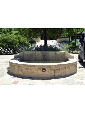 Large fountain in limestone with one faucet