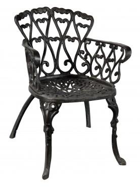 Cast iron armchair heavy and sturdy