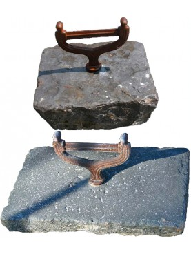 castiron boot scraper mounted on stone