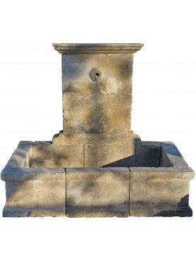 Fontana in pietra con lavatoio