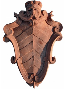 Terracotta coat of arms with satyr