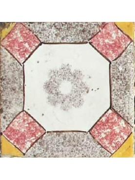 Piastrella antica di maiolica con fiore