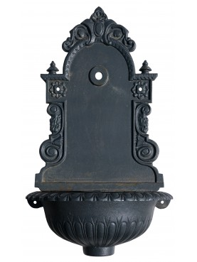 Cast iron wall fountain with scallopped basin