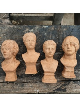 Small hand-formed terracotta bustiers