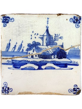 Ancient majolica Delft tile with Dutch mill