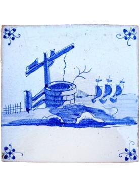 Piastrella Delft antica maiolicata olandese con il pozzo