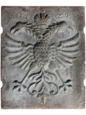 Lastra di camino in bronzo Aquila bicipite datata 1729