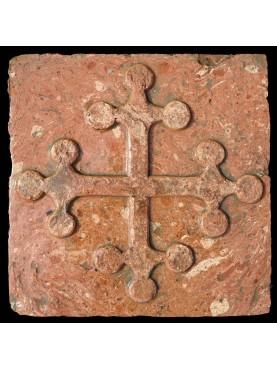 Pisa cross on the brick