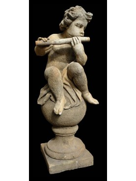 Putto on the ball with flute