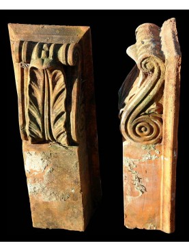 Two small terracotta brackets