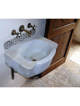 Sink, tiles and stone floor: all from salvage