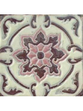 Piastrella di maiolica a rilievo marrone